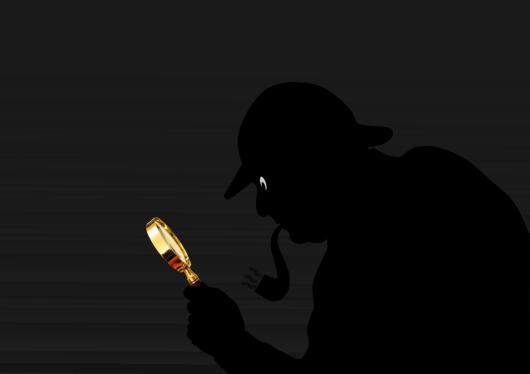 調査する探偵